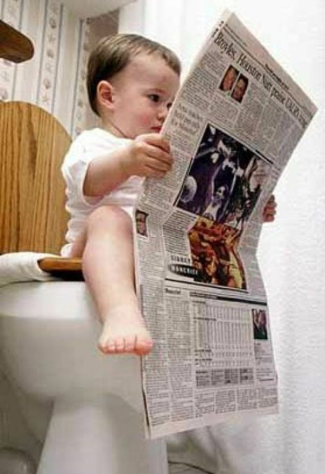 baby reading newspaper