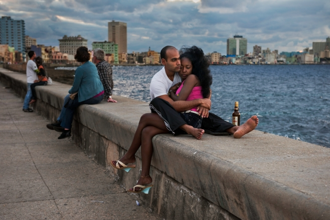 _SM17706, Havana, Cuba, 12/2010, CUBA-10028. A couple sits on the Malecon, embracing one another. retouched_Ekaterina Savtsova 11/07/2014