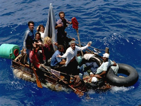 ** FILE ** In this Aug. 24, 1994 file photo, Cuban refugees stranded on a makeshift raft float in the open sea about halfway between Key West, Fla., and Cuba, as the exodus from their homeland continues despite a reversal in U.S. immigration policy. Cuba will celebrate on Jan. 1, 2009 the 50th anniversary of the triumph of the revolution. (AP Photo/Hans Deryk, File)