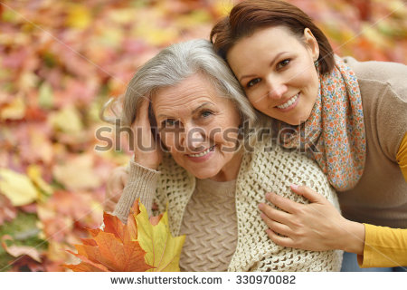 mother-and-her-nice-daughter-in-autumn-park-330970082