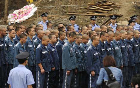 Chinese prisoners are lined up at the Do