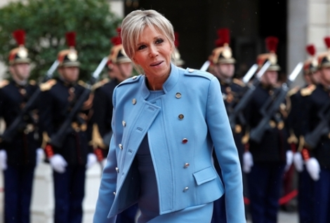 Brigitte Trogneux arrives to attend the handover ceremony between her husband, French President-elect Emmanuel Macron, and outgoing President Francois Hollande at the Elysee Palace in Paris