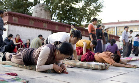 Worshippers at the Jokhang temple in Lhasa where two monks are said to have set themselves on fire