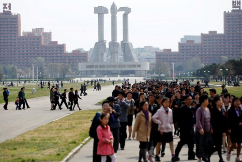 FILE PHOTO: People walk in front of the Monument to the Foundation of the Workers' Party in Pyongyang